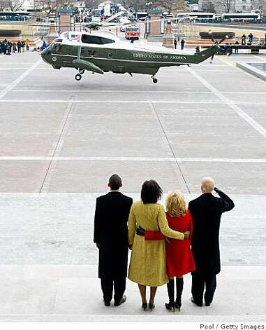 WASHINGTON - JANUARY 20:  US President Barack Obama stands alongside his wife, Michelle, as US Vice President Joe Biden salutes alongside his wife, Jill, as former US President George W. Bush and his wife, Laura, leave the US Capitol on the presidential helicopter after Obama was sworn in as the 44th US president in Washington, DC, on January 20, 2009.  (Photo by Saul Loeb-Pool/Getty Images) Photo: Pool, Getty Images