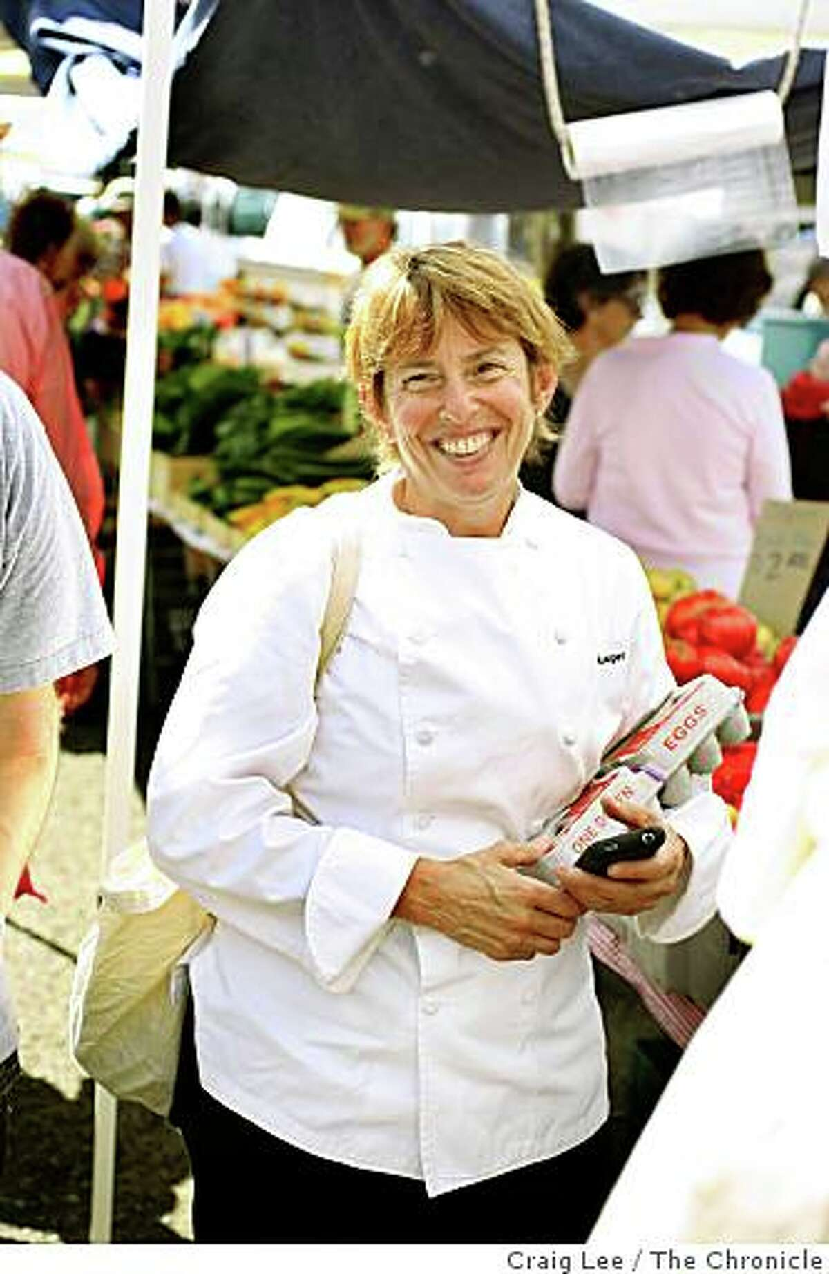Chef Ann Cooper, of the Berkeley Unified School District, grocery shopping at the Berkeley Farmer's Market, for five school lunches on $20 or less in Berkeley, Calif., on August 19, 2008.