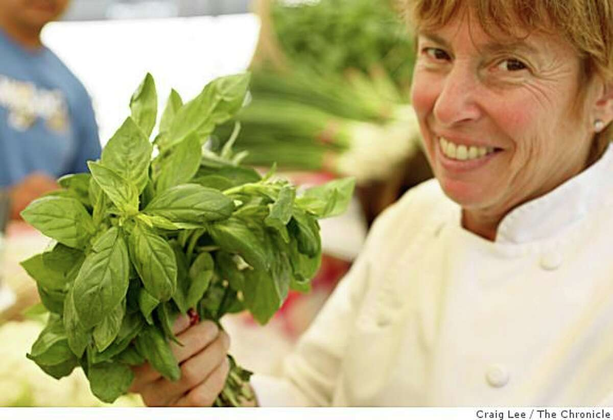 Chef Ann Cooper, of the Berkeley Unified School District, grocery shopping at the Berkeley Farmer's Market, for five school lunches on $20 or less in Berkeley, Calif., on August 19, 2008. Ann Cooper with some basil.