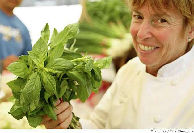 Chef Ann Cooper, of the Berkeley Unified School District, grocery shopping at the Berkeley Farmer's Market, for five school lunches on $20 or less in Berkeley, Calif., on August 19, 2008. Ann Cooper with some basil. Photo: Craig Lee, The Chronicle