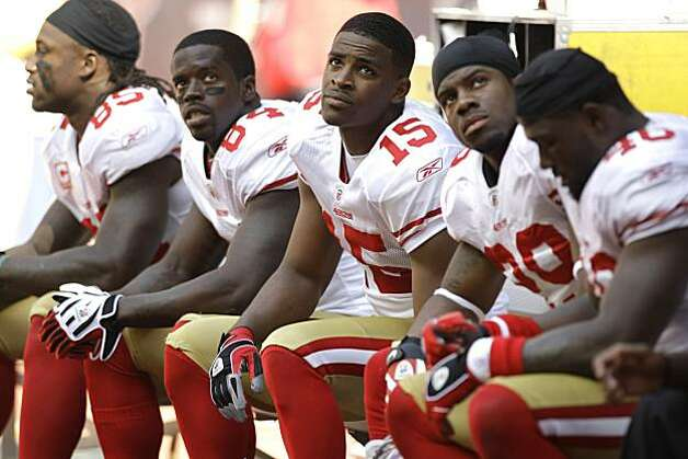 San Francisco 49ers recievers Vernon Davis (85), Josh Morgan (84) and Michael Crabtree (15) sit on the bench during the 2nd quarter of an NFL football game at Reliant Stadium Sunday, Oct. 25, 2009, in Houston. ( Brett Coomer / Chronicle ) Photo: Brett Coomer, Chronicle