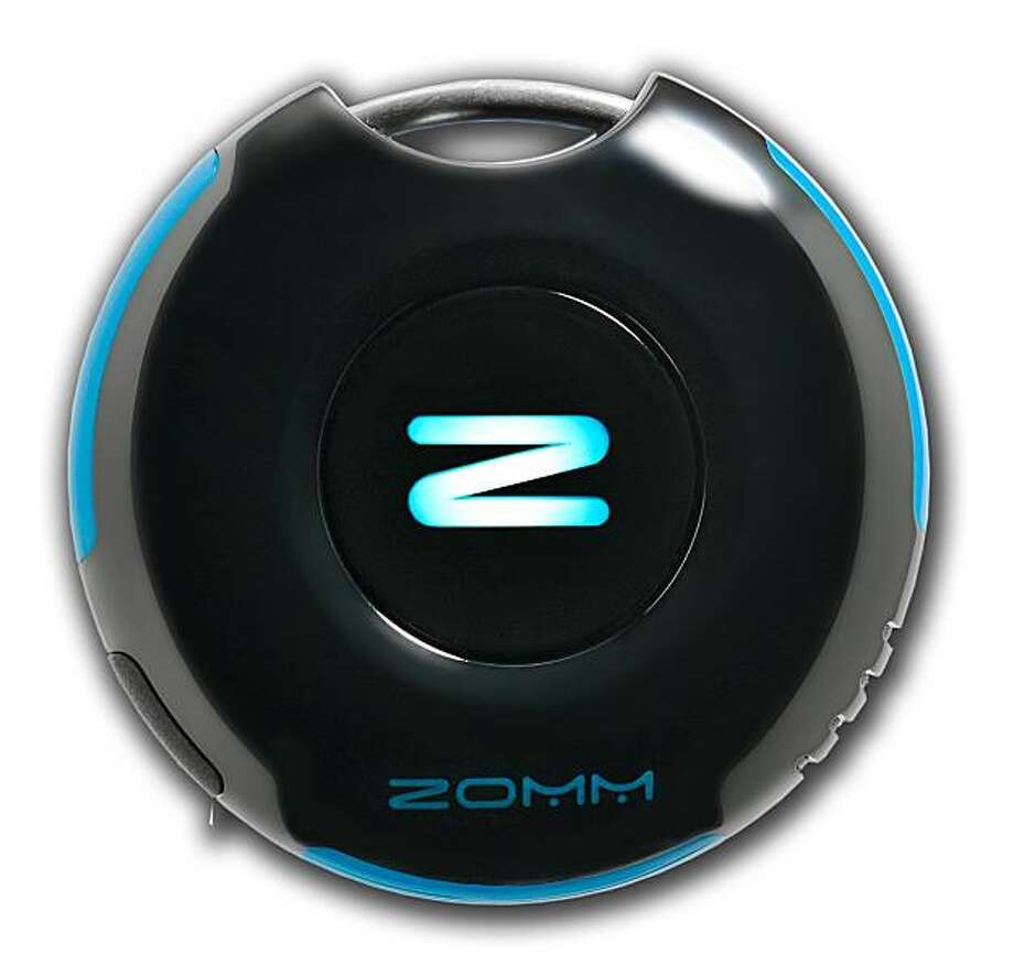 The $79.95 Zomm electronic locator device is seen in this undated handout photo provided to the media on Thursday, Sept. 2., 2010. Using Bluetooth technology, the keychain-sized Zomm vibrates, flashes lights and sounds an alarm when a user separates more than 30 feet from a mobile phone or other linked device. About 30 million wireless phones go missing in the U.S. every year according to Asurion Corp. Source: Blastmedia via Bloomberg EDITOR'S NOTE: EDITORIAL USE ONLY. NO SALES. Photo: Via Bloomberg