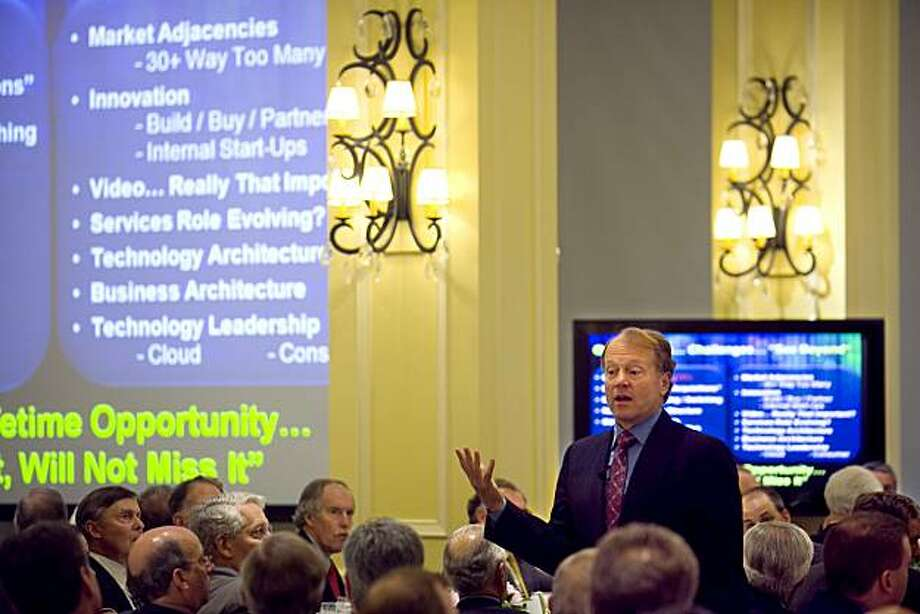 "John Chambers, chairman and chief executive officer of Cisco Systems Inc., speaks to the Chief Executives' Club of Boston in Boston, Massachusetts, U.S., on Friday, June 11, 2001. Chambers said high U.S. taxes remain the major reason California-based Cisco has $40 billion in cash overseas and suggested America's opportunity to ""bring back the cash"" may be limited. Photographer: Michael Fein/Bloomberg Photo: Michael Fein, Bloomberg"