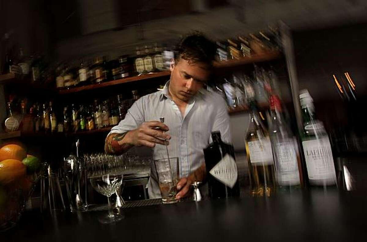 Bar manager Morgan Schick prepares his specialty drink, a