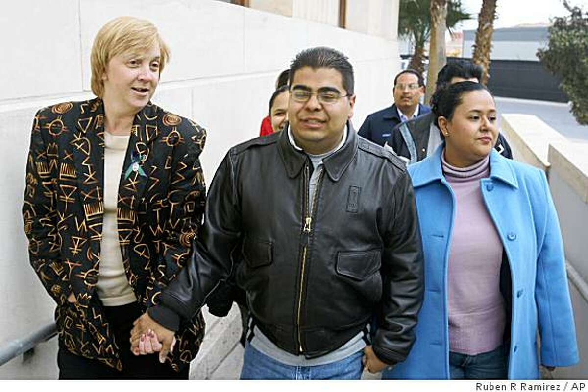 **FILE** In this Jan. 17, 2007 file photo former U.S. Border Patrol agent Jose Alonso Compean, center, walks hand-in-had with his wife, Patty, right, and lawyer, Mary Stillinger, as he arrives to surrender to federal authorities at the federal courthouse in El Paso, Texas. President George W. Bush on Monday, Jan. 19, 2008 commuted Compean's prison sentence, whose convictions for shooting a Mexican drug dealer ignited fierce debate about illegal immigration. (AP Photo/The El Paso Times, Ruben R. Ramirez) ** EL DIARIO OUT, JUAREZ, MEXICO OUT, EL PASO OUT **