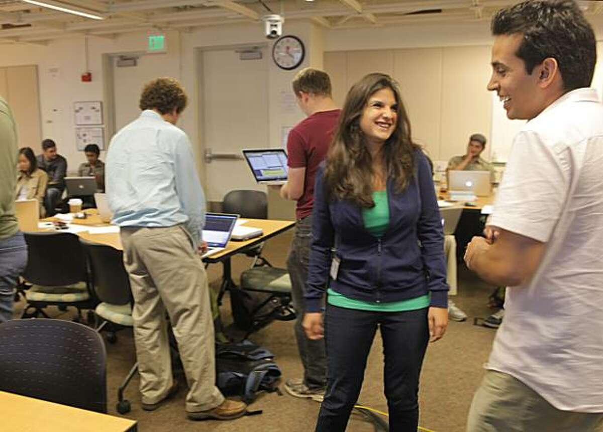 Roxana Daneshjou, center, talks with teacher Keyan Salari, right before her presentation for the exercise on genetics, Wednesday August 11, 2010, in the Stanford University's of Medicine genetic testing course, in Stanford, Calif.