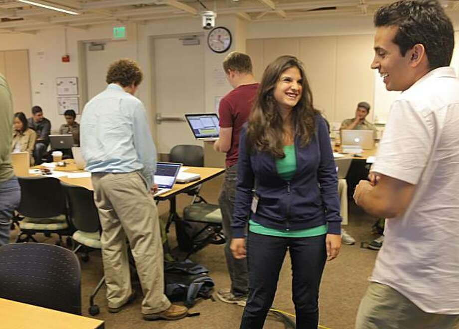 Roxana Daneshjou, center, talks with teacher Keyan Salari, right before her presentation for the exercise on genetics, Wednesday August 11, 2010, in  the Stanford University's of Medicine genetic testing course,  in Stanford, Calif. Photo: Lacy Atkins, The Chronicle