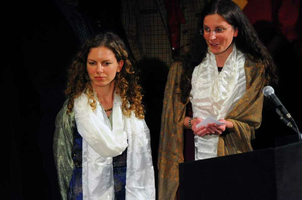 Sara Bronfman, left, and Clare Bronfman, right, speak after an appearance by the Dalai Lama at the Palace Theatre in Albany, N.Y., Wed., May 6, 2009. (Philip Kamrass / Times Union)