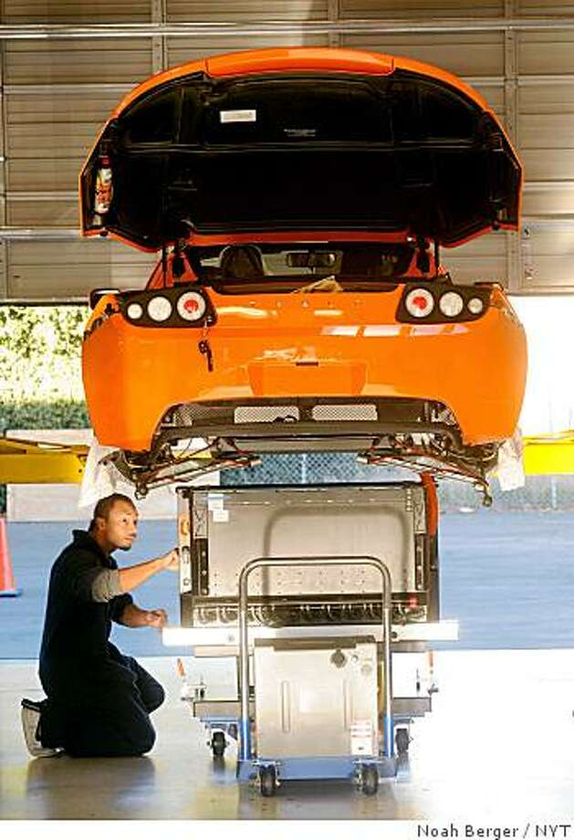 (NYT36) MENLO PARK, CA -- November 28, 2008 -- TELSA-MOTORS -- A technician at Tesla Motors in Menlo Park, Calif., at work on an all-electric car on Nov. 21, 2008. Tesla wants $400 million in loans from a fund for improving automakers� fuel efficiency. (Noah Berger/The New York Times) -ADV. 1130 Photo: Noah Berger, NYT