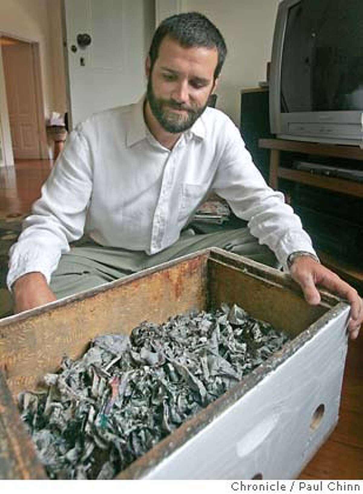 Timothy Burroughs, Climate Action Coordinator for the city of Berkeley, keeps a worm bin to produce compost in the living room of his home in Berkeley, Calif. on Friday, July 6, 2007. PAUL CHINN/The Chronicle **Timothy Burroughs