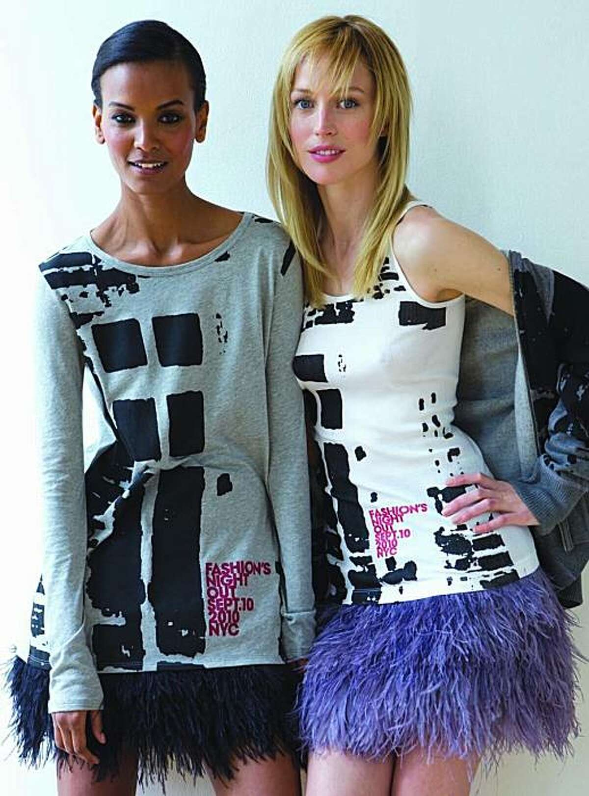 Models Liya Kebede and Raquel Zimmermann show the official Fashion's Night Out collection. Forty percent of the proceeds raised from the sales of these shirts will go to the NYC AIDS fund.