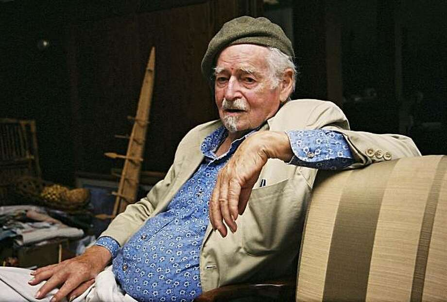 Surrealist poet and playwrite George Hitchcock sits July 14, 2004, in his home in Harrisburg, Ore. Called before the House Committee on Un-American Activities in 1957 to answer for his leftist activities, Hitchcock went on to edit and publish ``kayak,'' a literary magazine that helped shape American poetry from 1964 to 1984. (AP Photo/Jeff Barnard) Photo: Jeff Barnard, Associated Press