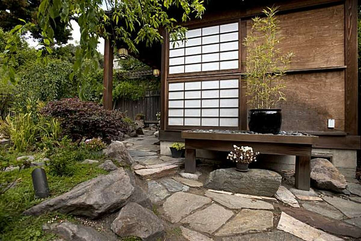 Jim and Bonnie Bell have created a personal sanctuary in their backyard that features a custom-built Japanese style tea house complete with water features and a koi pond and is photographed in Berkeley, Calif., on Sunday, August 8, 2010.