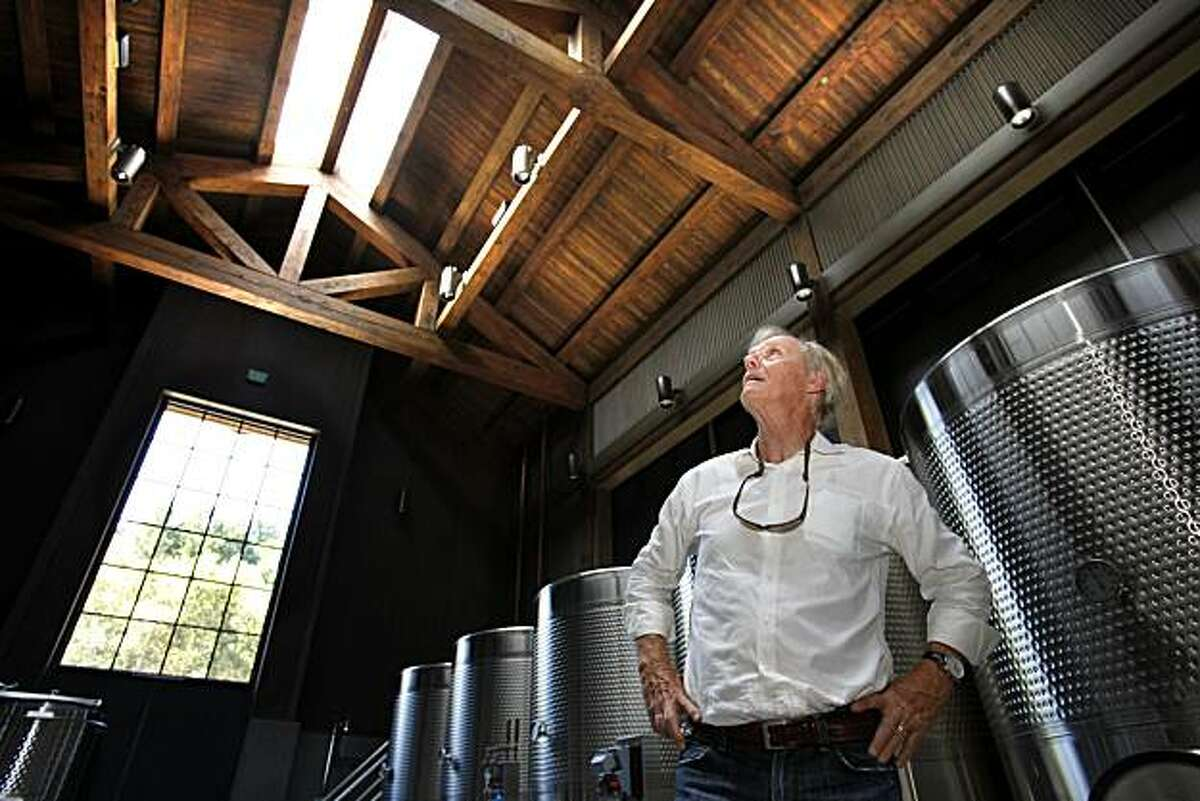 At the Futo Winery, Howard Backen looks up at the high wooden beam ceilings he designed and window lighting. Howard Backen, architect of wine country mansions and wineries, talks about design in his life Thursday September 2, 2010.