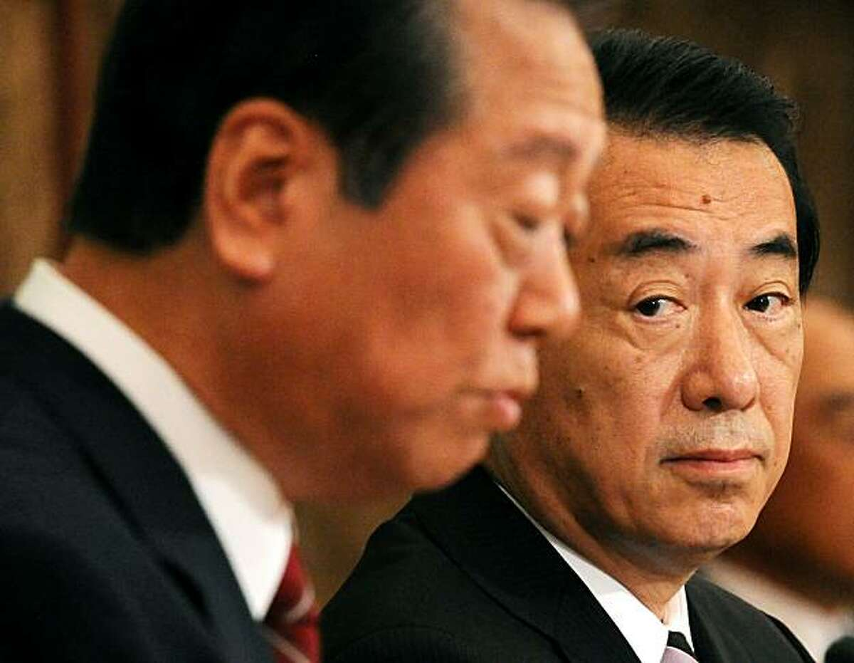 Japanese Prime Minister Naoto Kan (R) of the ruling Democratic Party of Japan (DPJ) listens as his rival Ichiro Ozawa (L) answers a question during their debate for the DPJ leadership contest at Japan National Press Club in Tokyo on September 2, 2010. Therivals, who both formally declared their candidacy for the September 14 party election, represent the two different wings of the party which a year ago ousted the conservatives after more than half as century in power. If Ozawa wins, he will become Japan's sixth premier in four years.