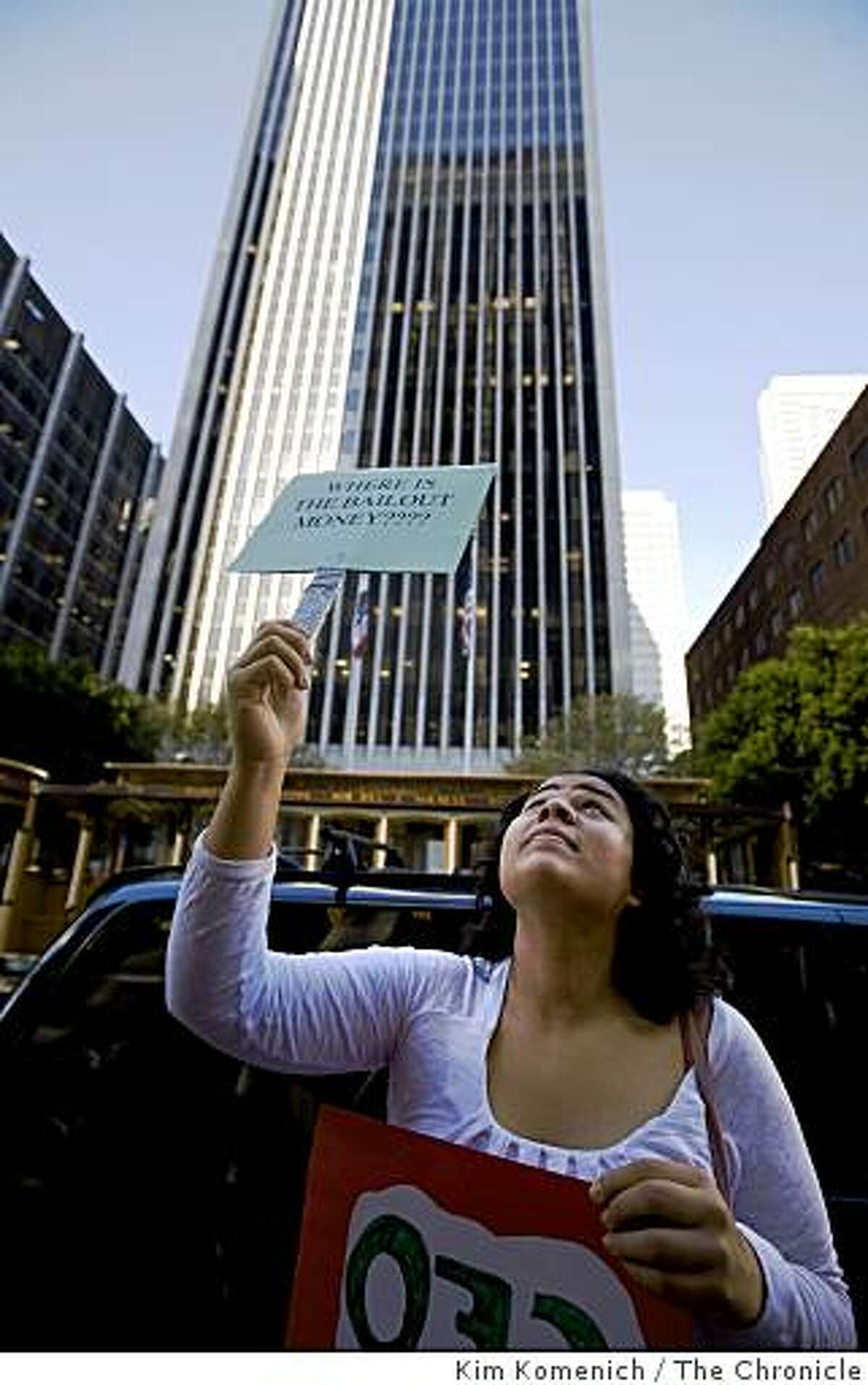 Andrea Putman of San Jose, Calif., holds a sign outside One California Street in San Francisco, Calif., as protesters marched through the city's financial district on Thursday, Jan. 15, 2009, calling on major banks that received billions in federal bailout funds to do more to funnel that money to the communities most in need.