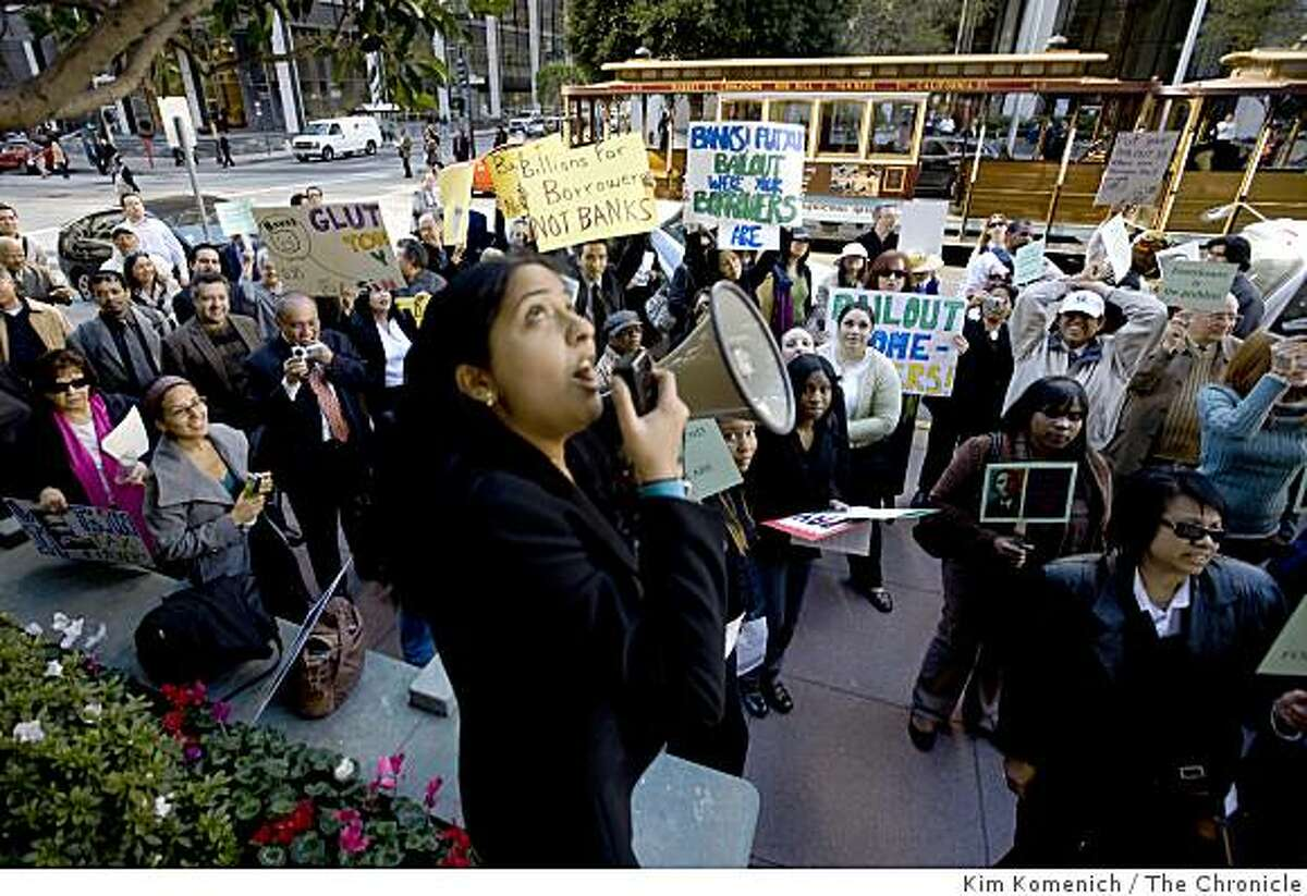 Preeti Vissa of the Greenline Institute leads the protest outside One California Street as about 100 protesters marched through San Francisco�s financial district on Thursday, Jan. 15, 2009, calling on major banks that received billions in federal bailout funds to do more to funnel that money to the communities most in need.