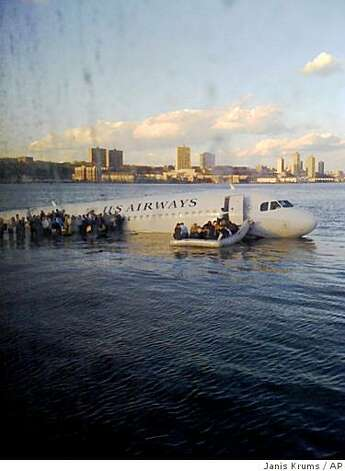 In this photo taken by a passenger on a ferry, airline passengers egress a US Airways Airbus 320 jetliner that safely ditched in the frigid waters of the Hudson River in New York, Thursday Jan. 15, 2009 after a flock of birds knocked out both its engines. All 155 people on board survived. (AP Photo/Janis Krums) Photo: Janis Krums, AP