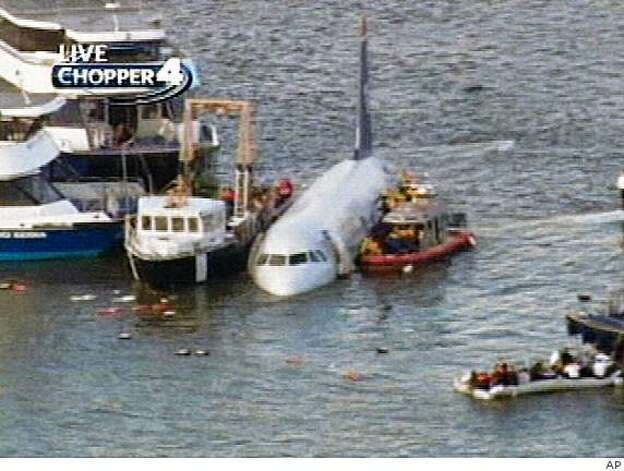 This video frame grab image taken from WNBC-TV shows a US Airways aircraft that has gone down in the Hudson River in New York, Thursday Jan. 15, 2009. It was not immediately clear if there were injuries. (AP Photo/WNBC-TV) ** MANDATORY CREDIT ** NO SALES ** Photo: AP