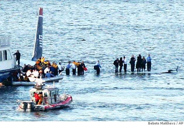Passengers in an inflatable raft prepare to move away from an Airbus 320 US Airways aircraft that has gone down in the Hudson River in New York, Thursday Jan. 15, 2009. It was not immediately clear if there were injuries. (AP Photo/Bebeto Matthews) Photo: Bebeto Matthews, AP