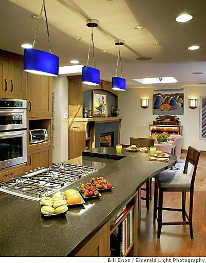 Harrell and Benson's kitchen showing the island with its heated counter top. Photo: Bill Enos, Emerald Light Photography