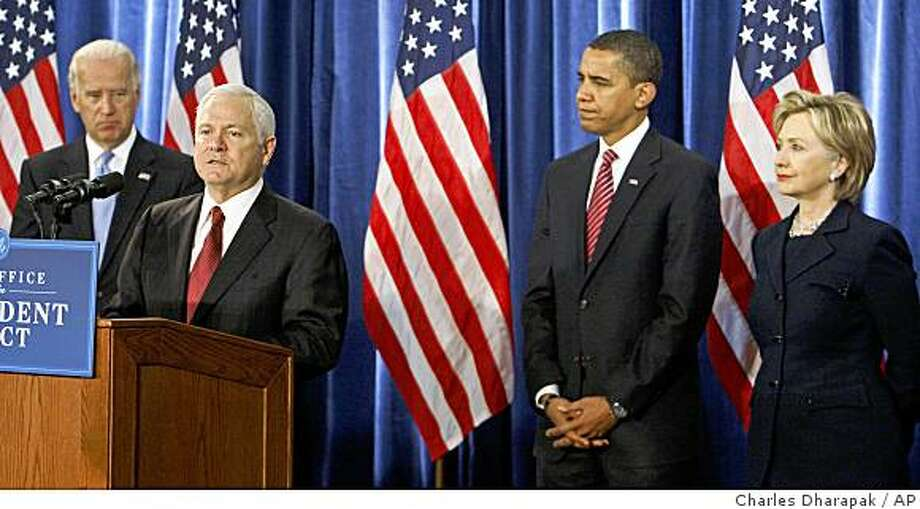 ** FILE ** In this Dec. 1, 2008 file photo, Defense Secretary Robert Gates, second left, speaks as Vice President-elect Joe Biden, left, President-elect Barack Obama; and Secretary of State-designate Hillary Rodham Clinton, far right, listen at a news conference in Chicago.  (AP Photo/Charles Dharapak, File) Photo: Charles Dharapak, AP