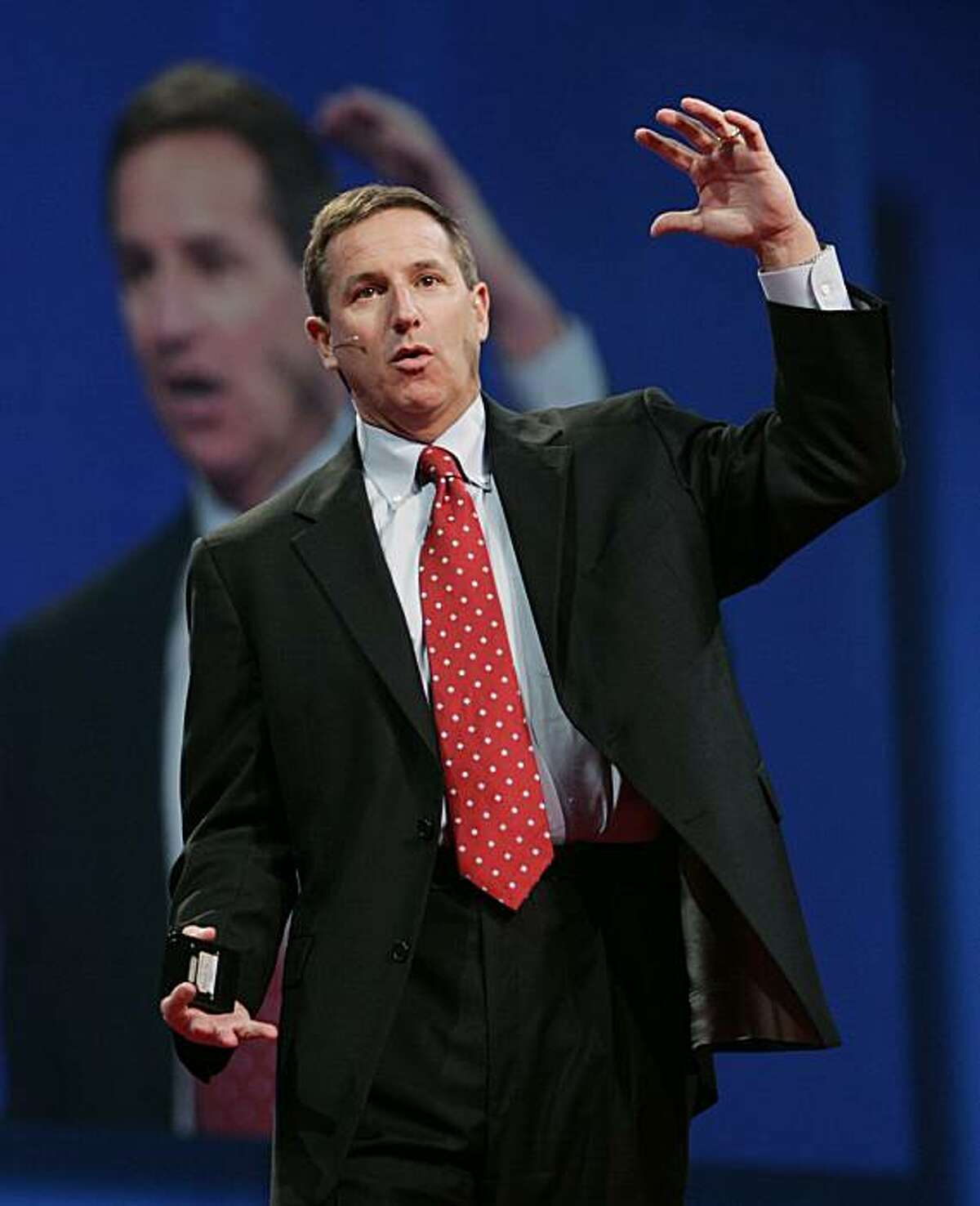 FILE - In this Oct. 24, 2006 file photo, Hewlett Packard CEO Mark Hurd gestures during a keynote address at the Oracle Open World conference in San Francisco. The woman at the center of the sexual harassment claim that forced the resignation of Hewlett-Packard Co. CEO Mark Hurd revealed her identity Sunday and said she is