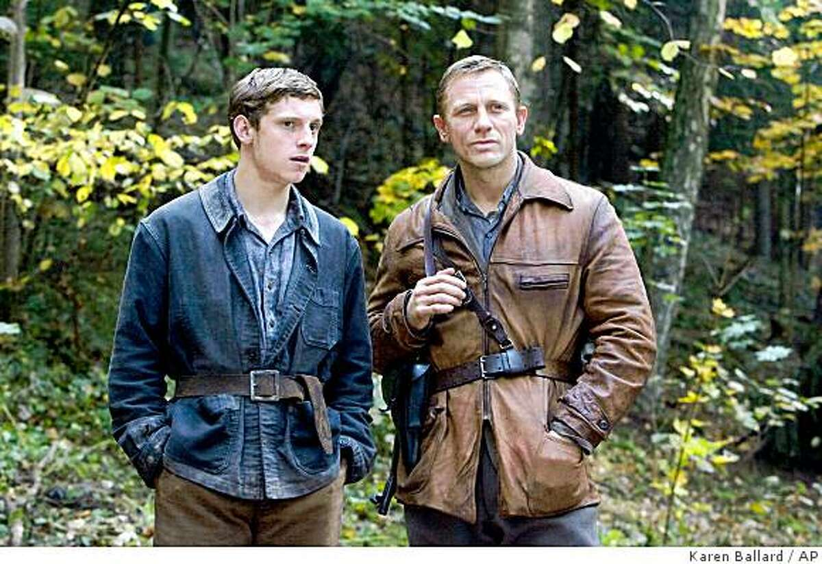 In this image released by Paramount Vantage, Jamie Bell portrays Assael Bielski, left, and Daniel Craig portrays Tuvia Bielski in a scene from the film,