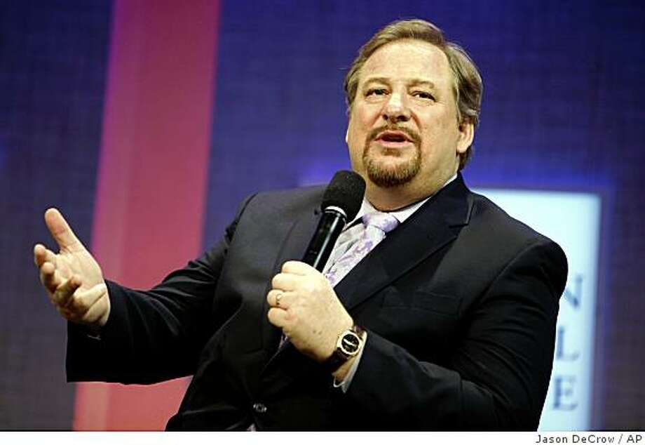 **FILE** This Sept. 26, 2008 file photo shows Rick Warren, pastor of Saddleback Church, as he speaks during a panel discussion on rural development at the Clinton Global Initiative annual meeting in New York. Barack Obama's choice of clergy is under scrutiny, outraging Americans on the left and right in the tense landscape of U.S. religion.  (AP Photo/Jason DeCrow, FILE) Photo: Jason DeCrow, AP