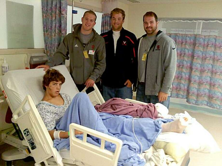 In this undated photo provided by the Phillips family, plane crash survivor Willy Phillips Jr., 13, in bed, is shown with his brothers, from left,  Paul, Colt and Andrew Phillips at Providence Alaska Medical Center in Anchorage, Alaska. Phillips was one of four survivors of the Aug. 9, 2010, plane crash near Dillingham. Among the five people killed was his father, William Phillips. A memorial service for him will be held Friday, Aug. 20, 2010, in Potomac, Md. Photo: Courtesy Of Phillips Family