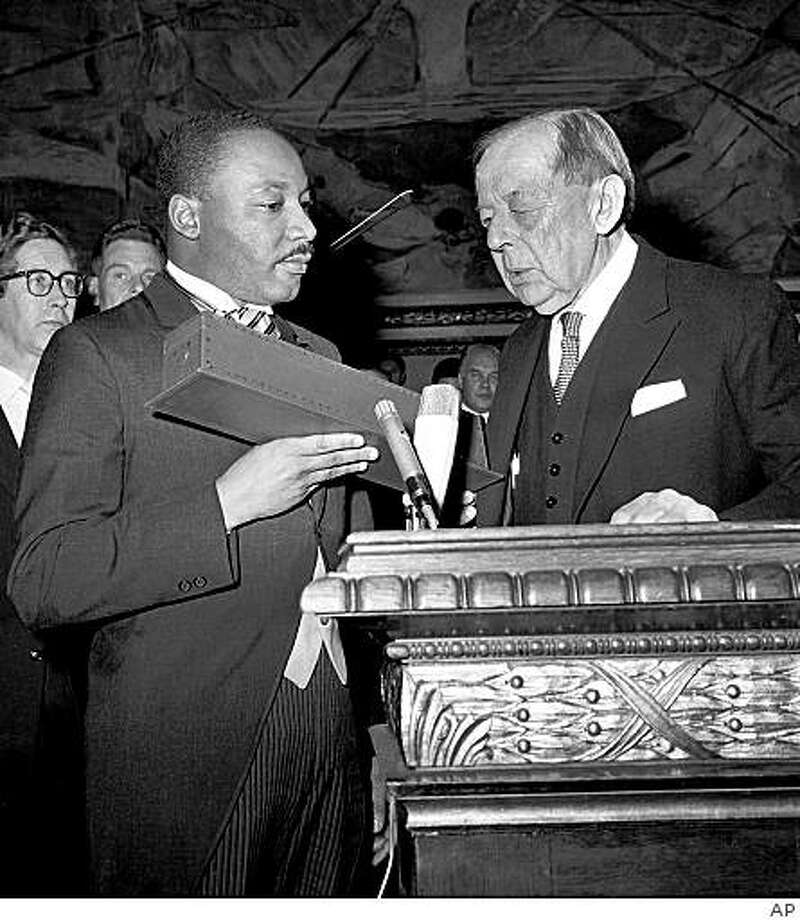 ** FOR USE ANYTIME WITH MARTIN LUTHER KING DAY FEATURES - FILE ** Dr. Martin Luther King Jr., American civil rights leader, left, receives the Nobel Peace Prize from the hands of Gunnar Jahn, Chairman of the Nobel Committee, in Oslo, Norway,in this Dec. 10, 1964, file photo. (AP Photo) Ran on: 01-16-2006 The Rev. Martin Luther King Jr. accepts the Nobel Peace Prize from the chairman of the Nobel Committee in Oslo. Photo: AP