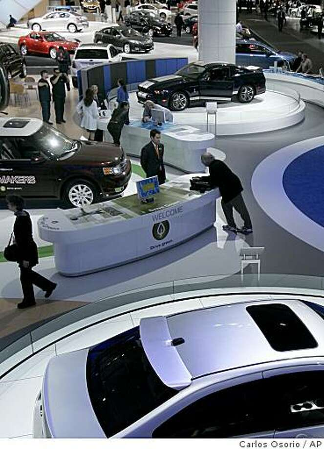 The Ford display is seen at the North American International Auto Show in Detroit, Tuesday, Jan. 13, 2009. (AP Photo/Carlos Osorio) Photo: Carlos Osorio, AP