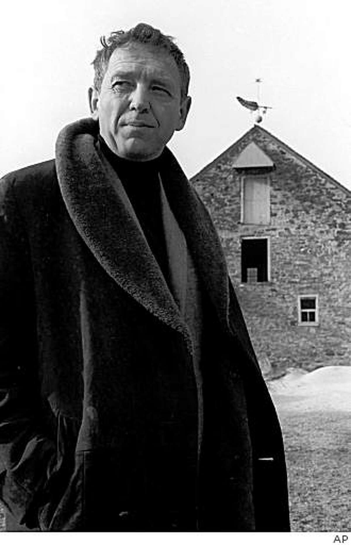**ADDS ATTRIBUTION** ** FILE **In this Feb. 23, 1964, file photo, artist Andrew Wyeth stands in front of his farm in Chadds Ford, Pa. Wyeth has died at the age of 91 at his home outside Philadelphia according to Hillary Holland, a spokeswoman for the Brandywine River Museum. (AP Photo,File)