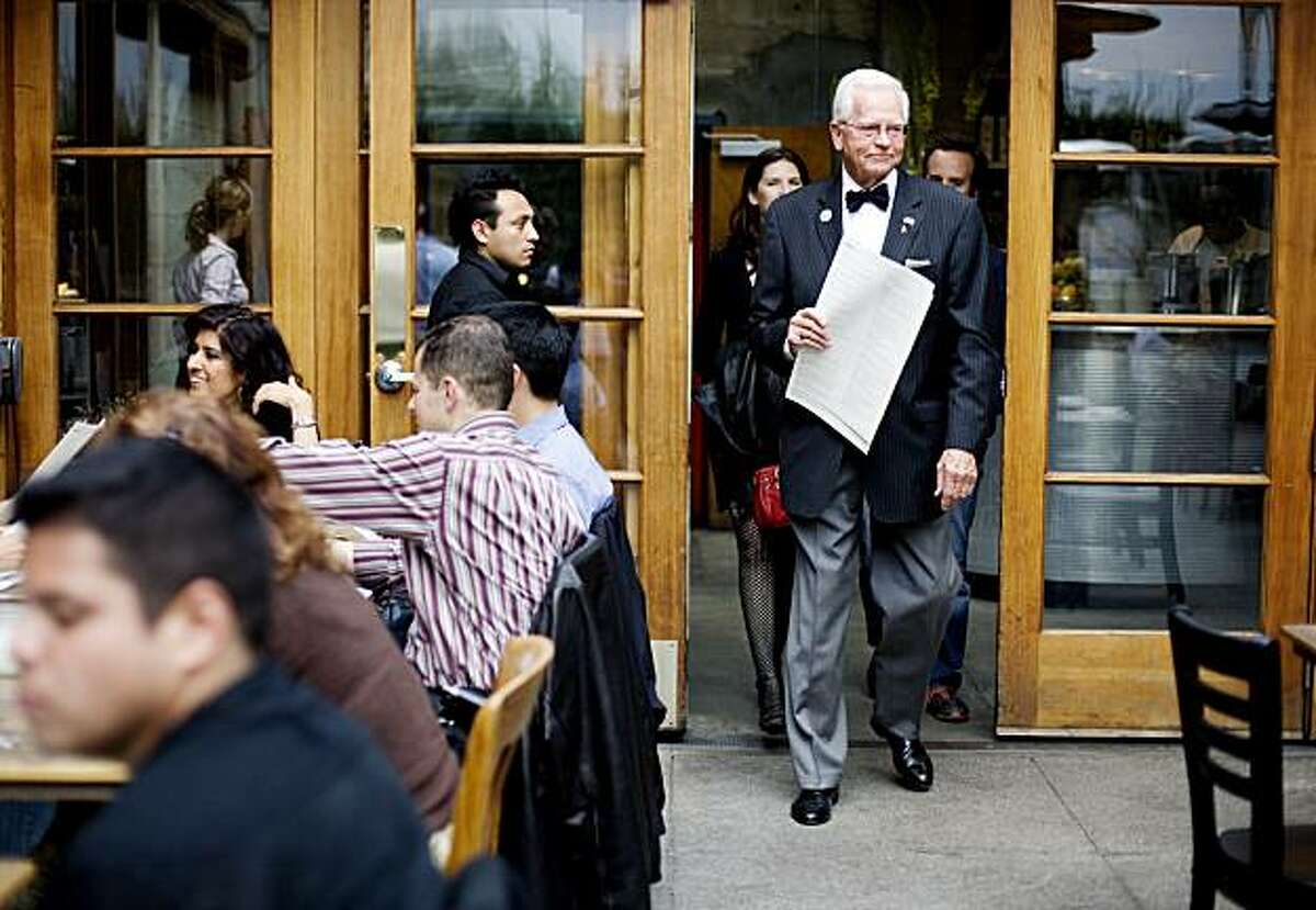 Restaurant maitre d' Greig Pirie, father of chef and owner, Gayle Pirie, walks customers to their table in the patio of Foreign Cinema, in San Francisco, Ca., on Friday, June 12, 2009.