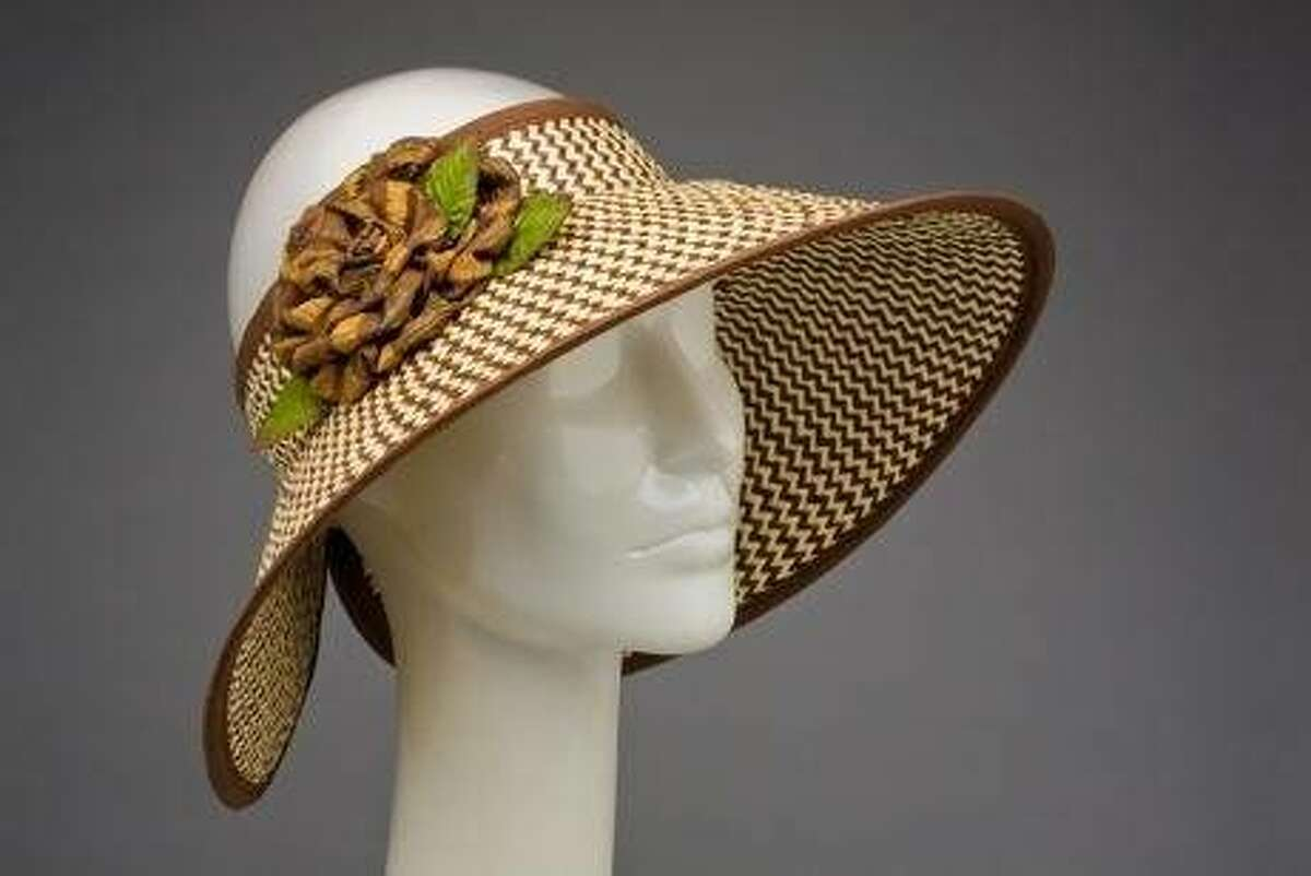 Jax Hatz of San Francisco makes a variety of hats from fedoras to visors with feathers to forehead-mounted hats worthy of Britain's Royal Ascot. Increasingly popular, says Jax Hatz proprietor Jacqueline Ryan, are anything with feathers, and fedoras for men and women. This woman's hat features a visor-like style. This style is the