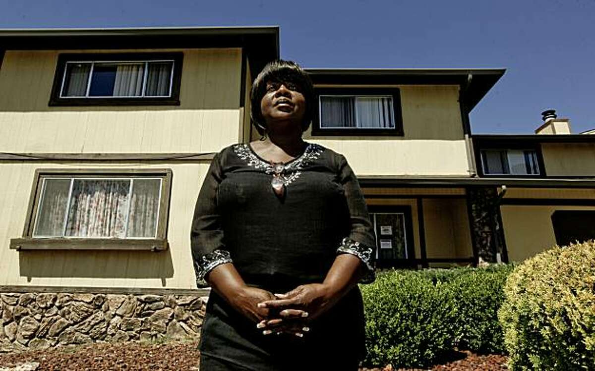 Dianne Huntsberry, on Wednesday Sept. 1, 2010, in front of her former home which she says she was scammed out of in Oakland, Calif. last November of 2009 and is now bank owned. Alameda County Health Department released data today showing the health effects on people's lives who go through the foreclosure process.