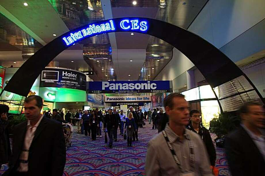 The Consumer Electronics Association said there were more than 110,000 attendees at its recent show in Las Vegas. That's far less than the 130,000 the organization conservatively predicted for this year and 23 percent off the 141,150 that attended last year.    LAS VEGAS - JANUARY 10:  People attend the 2009 International Consumer Electronics Show January 10, 2009 in Las Vegas, Nevada. CES, the world's largest annual consumer technology trade show, runs from January 8-11 and is expected to feature 2,700 exhibitors showing off their latest products and services to more than 130,000 attendees. (Photo by David McNew/Getty Images) Photo: David McNew, Getty Images