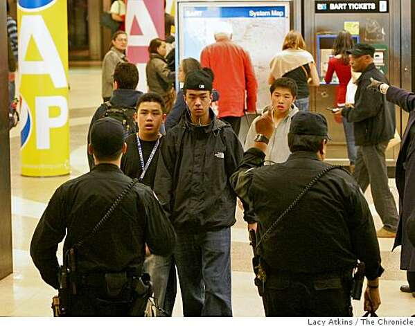 Police Officers stop people from getting down of the BART station at Powell and Market, Monday Jan. 12, 2009, due to protesters over the killing of Oscar Grant rally, in San Francisco, Calif. Photo: Lacy Atkins, The Chronicle