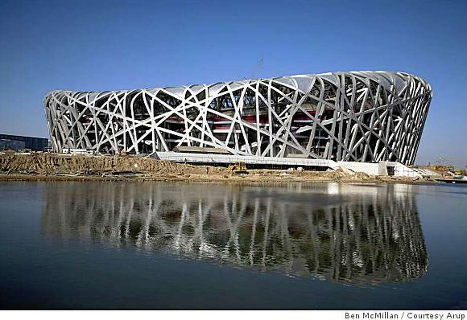 This the Beijing 2008 Olympics National Stadium...shot during construction. It was designed by an international team that included de Young museum designers Herzog and De Meuron architects based in Basel, and Steve Burrows, an engineer with Arup, the British engineering firm in London. It has a San Francisco office as well where Burrows now works. The stadium has been nicknamed as The Nest because of the steel lattice that gives it stabiulity as well as form Photo: Ben McMillan, Courtesy Arup