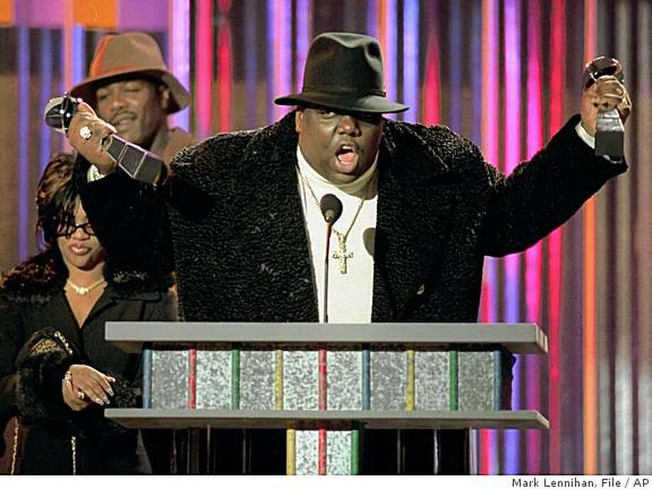 Notorious B.I.G., who won rap artist and rap single of the year, clutches his awards at the podium during the annual Billboard Music Awards in New York, in this Dec. 6, 1995 file photo. The family of the late Notorious B.I.G. lost a bid to expand their wrongful death lawsuit against Los Angeles to include new claims that a rogue police officer was on duty at the site of the killing. Photo: Mark Lennihan, File, AP
