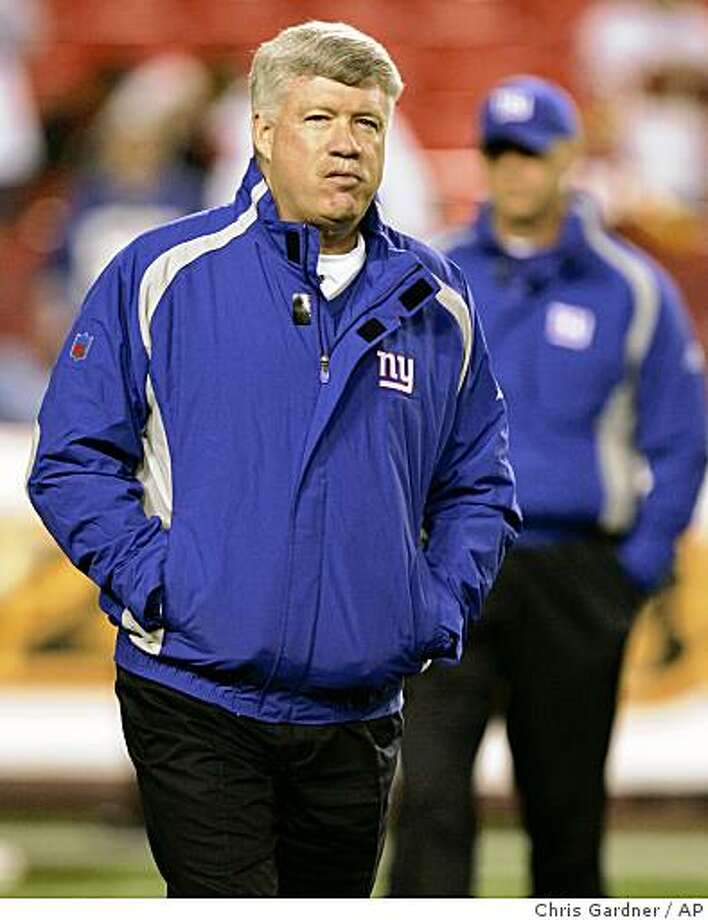 ** FILE ** In this Dec. 30, 2006, file photo, Kevin Gilbride, then quarterbacks coach of the New York Giants, watches as the players warm up before an NFL football game against the Washington Redskins in Landover, Md. Oakland Raiders owner Al Davis had a 90-minute phone conversation Saturday, Jan. 3, 2009, with Gilbride, now the Giants' offensive coordinator, about the team's coaching vacancy, according to Raiders senior executive John Herrera. (AP Photo/Chris Gardner, File) Photo: Chris Gardner, AP