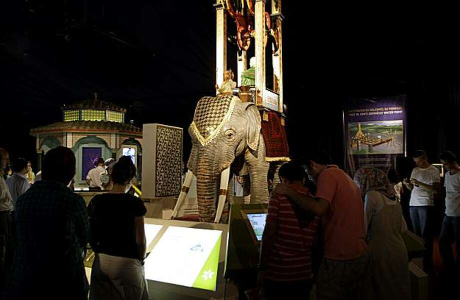 """In this photo of Monday Aug. 23, 2010 visitors view a piece at the """"1001 Inventions"""" exhibit in Istanbul, Turkey.The exhibition about innovation in Muslim civilization seeks to highlight what organizers say is an overshadowed period of history, a """"GoldenAge"""" in which advances in engineering, medicine and architecture laid groundwork for Western progress from the Renaissance until modern times. Photo: Ibrahim Usta, AP"""