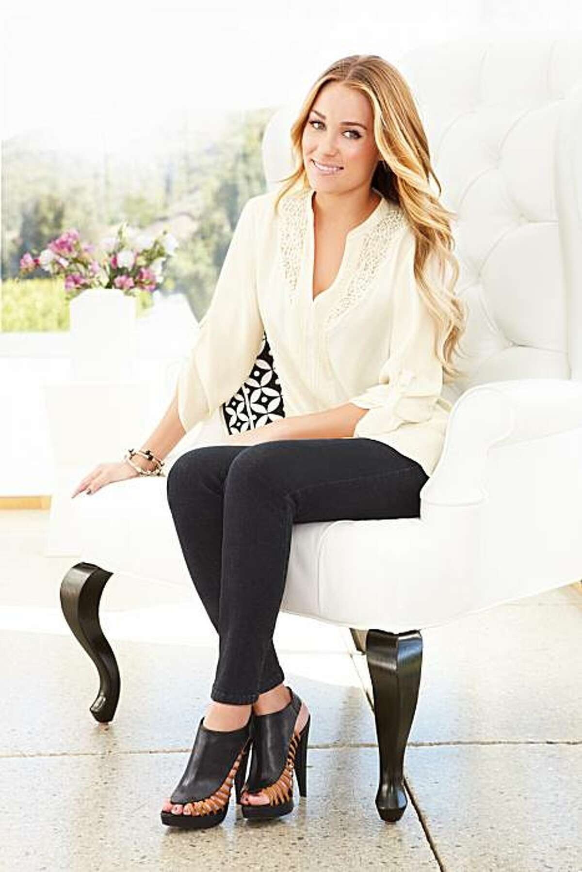 LC Lauren Conrad lace-trimmed pintuck top ($40) and LC Lauren Conrad black jeans ($54), available in October.