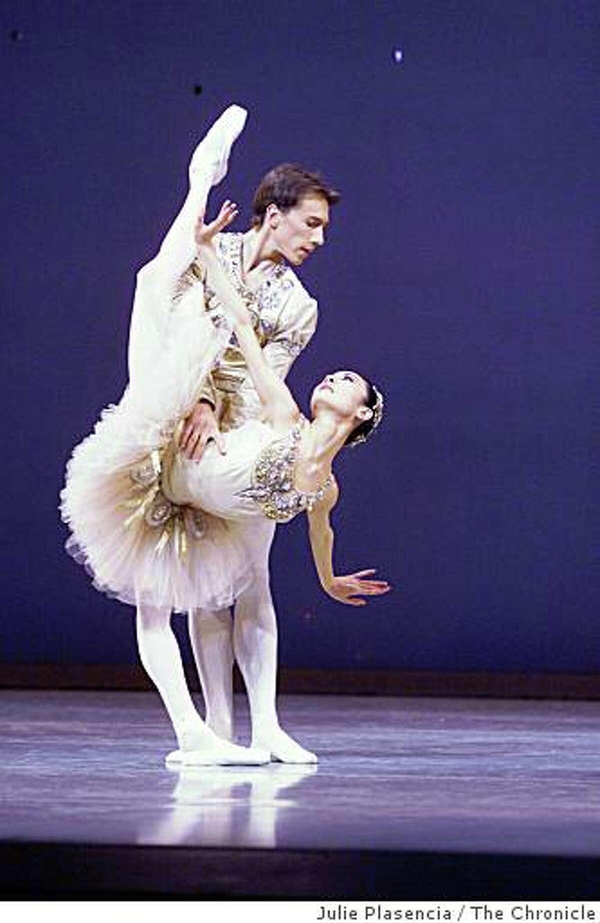 "JEWELS16h-C-12MAR02-DD-JP Principle dancers Yuan Yuan Tan and Roman Rykine in ""Diamonds"" segment of San Francisco Ballet's presentation of Jewels at the War Memorial Opera House in San Francisco. (JULIE PLASENCIA/SFC)"