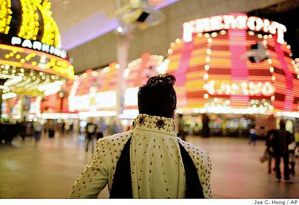 Elvis impersonator Jesse Grice walks down the Fremont Street Experience while waiting for a music video shoot in Las Vegas.