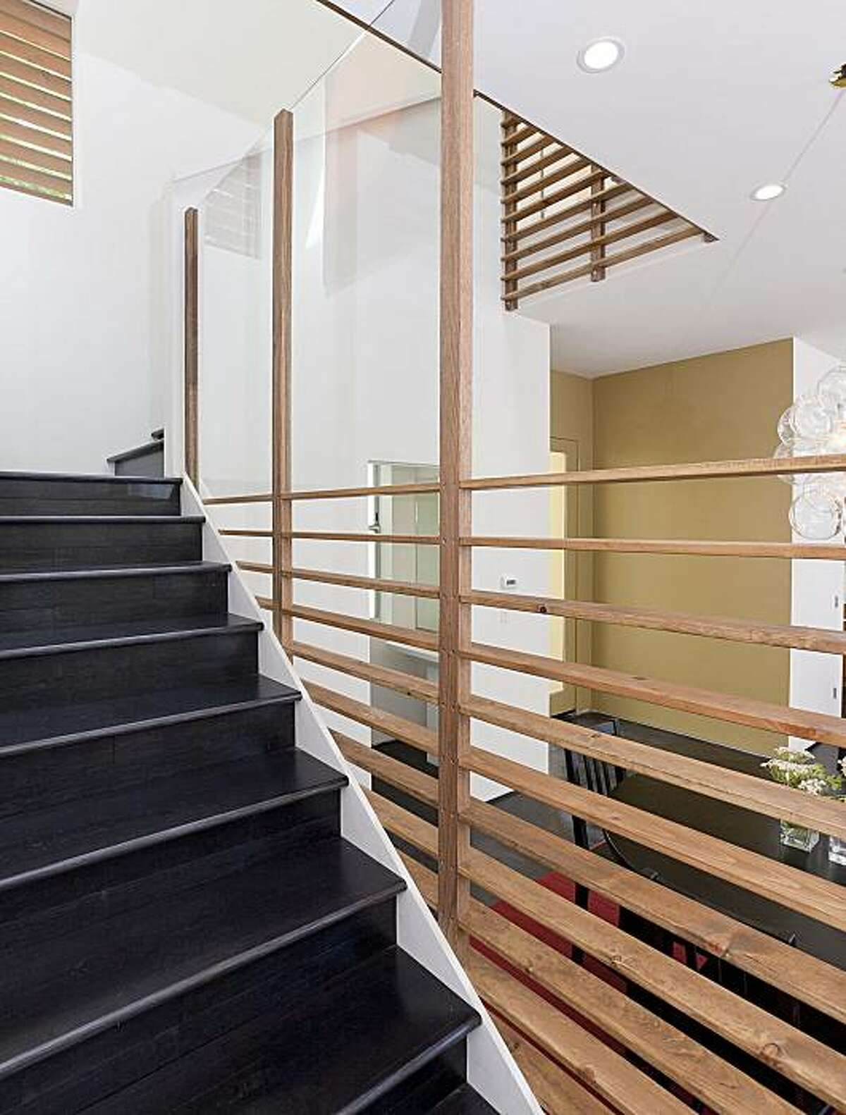 The staircase at 1089 55th Street in Oakland. The contemporary, 1,500-square-foot property includes two levels, with the upper floor housing the bedrooms. The bottom level is dedicated to the main living space.