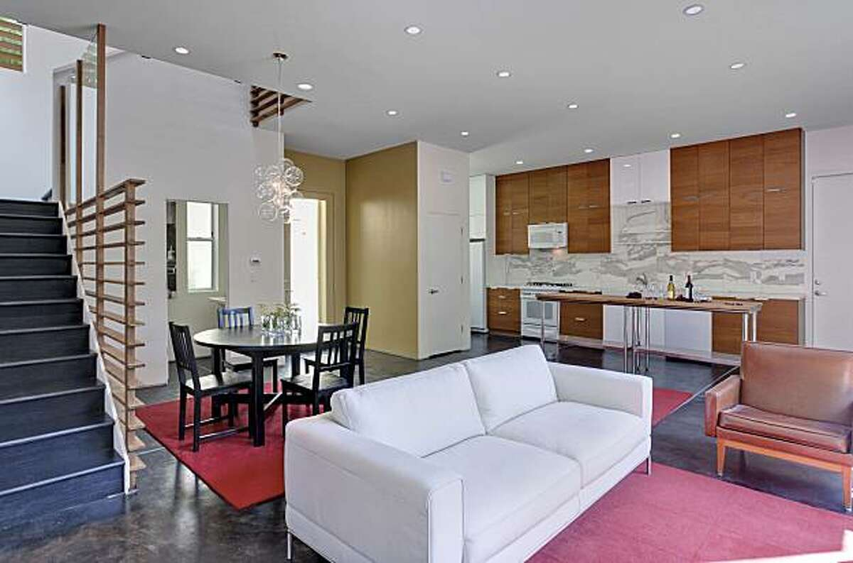 The living room, dining area and kitchen share the home's main level. 1089 55th Street in Oakland includes two bedrooms and two and a half bathrooms. At 1,500 square feet, it's on the market for $479,000.