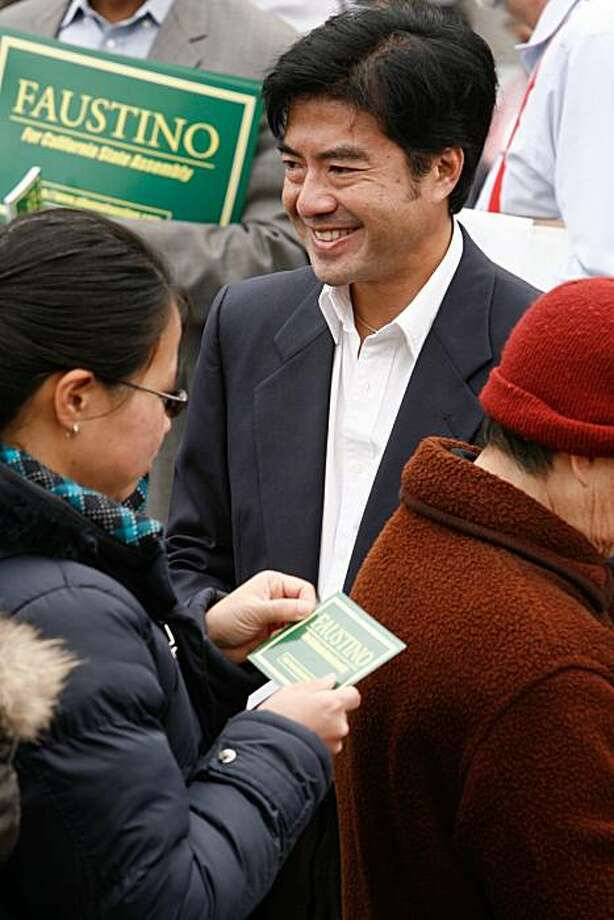 Republican candidate for State Assembly Alfonso Faustino hands out campaign cards to attendants of the Noriega Street Festival in a grassroots effort to gain voter support for his campaign on Saturday, August 21, 2010 in San Francisco, Calif. Photo: John Sebastian Russo, The Chronicle