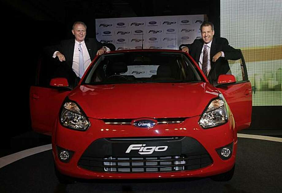 In this Tuesday, March 9, 2010 file photo, Joe Hinrichs, right, Ford vice president and president of Asia, Pacific and Africa, and Michael Boneham, president and managing director of Ford India, pose with a newly launched Figo car in New Delhi, India. Ford Motor Co. furthered its push into Asia Thursday, Aug. 26, 2010, announcing plans for eight new vehicles in India and a $350 million investment, with partner Mazda Motor Corp., in their pickup truck plant in Thailand. Photo: Manish Swarup, AP