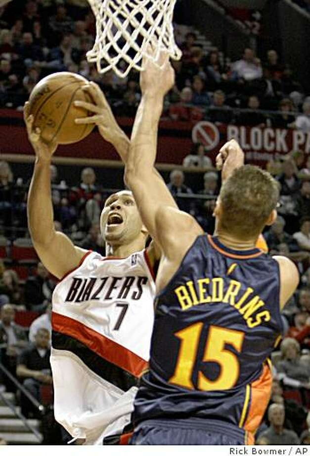 Portland Trail Blazers Brandon Roy (7) drives to the basket as Golden State Warriors Andris Biedrins (15), of Latvia, defends in the first quarter of their NBA basketball game Saturday, Jan. 10, 2009, at the Rose Garden, in Portland, Ore.  (AP Photo/Rick Bowmer) Photo: Rick Bowmer, AP
